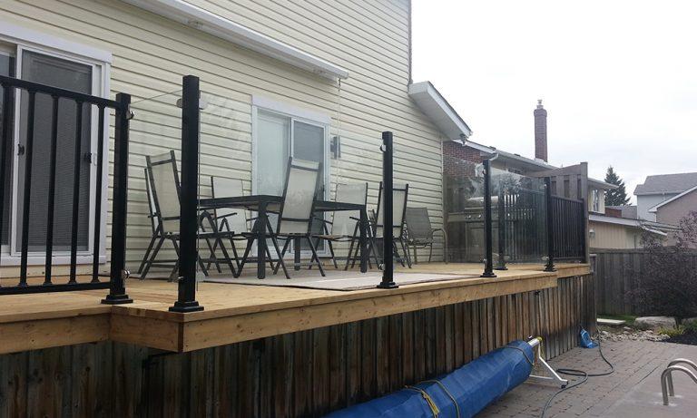 Back deck with InvisiRail glass railing